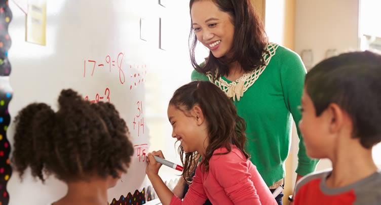 Teacher, children whiteboard